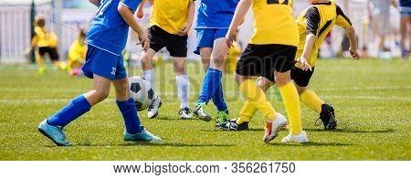 Soccer Shot. Young Boys Kicking Football Soccer Tournament Match On The Grass Pitch. Football Player