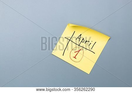 April Fools Day Reminder On Yellow Sticky Note In Form Of Calendar. Be Aware And Do Not Let Be Foole
