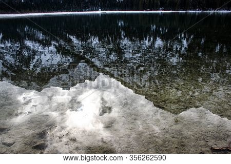 The Snowy Dolomites Are Reflected In The Calm Waters Of Lake Dobbiaco In Winter, Trentino Alto Adige