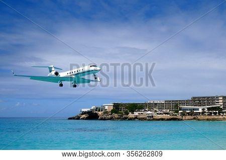 Plane Lands At Maho Beach In Saint Maarten
