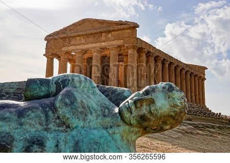 Ancient Statue Of The Fallen Icarus In The Front Of The Tempio Della Concordia In Valley Of The Temp