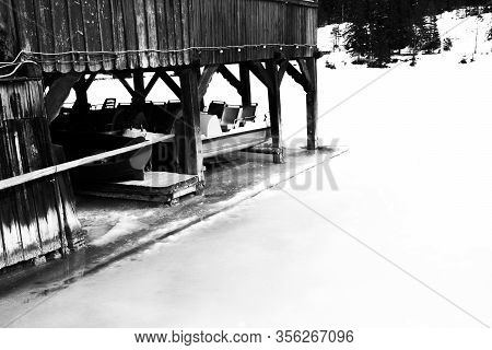 Pedal Boats Rest Under The Stilt House Of A Restaurant On The Banks Of The Frozen Lake Of Dobbiaco I