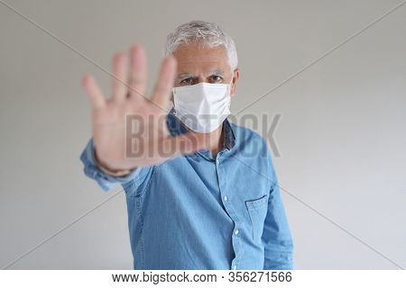 Man with protection mask, stopping virus - COVID19