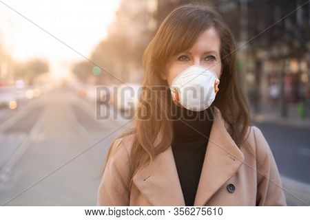 Coronavirus disease - woman wearing face mask in a public to protect herself from the covid-19 virus.