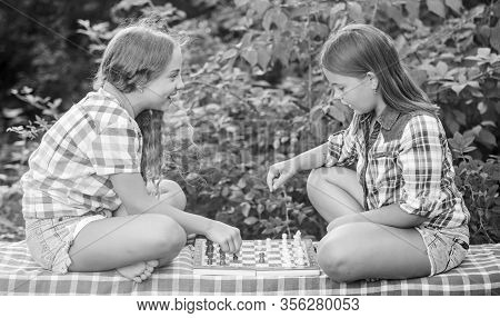 My Turn. Worthy Opponents. Develop Hidden Abilities. Two Concentrated Girls Play Chess. Chess Playin
