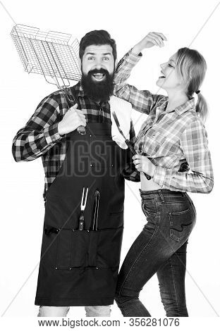 Bearded Hipster And Girl Hold Cooking Grilling Utensils White Background. Picnic And Barbecue. Famil