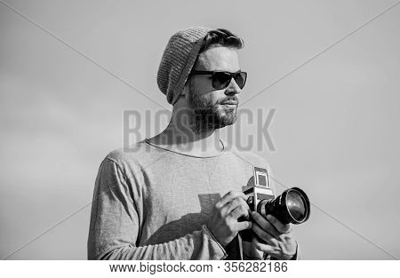 Hipster Reporter Taking Photo. Guy Photographer Outdoors Sky Background. Photojournalist Concept. Tr