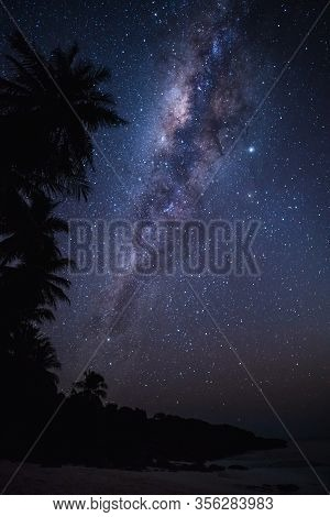 Clear Milky Way In The Dark Sky With Millions Of Stars On A Pristine Beach. Semau Island, Indonesia