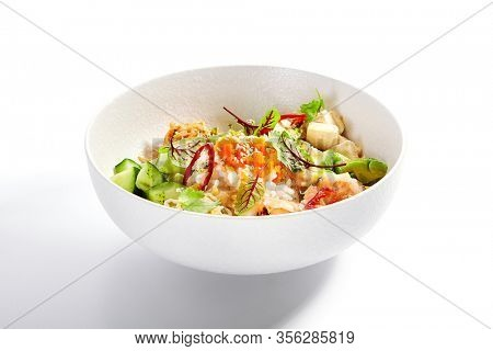 Poke with shrimp, avocado and seasonings. Traditional hawaiian cuisine. Tasty polynesian dish served with tofu cheese. Delicious salad with rice, edamame and soybean. Food composition