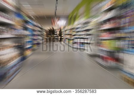 Shopping In The Supermarket During The Coronavirus Crisis Curfew, Few People Between Full Shelves, Z