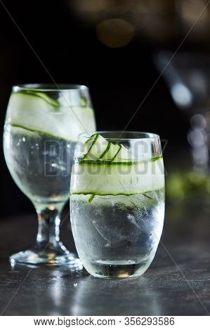 Gin And Tonic With Cucumber On Ice In Glass