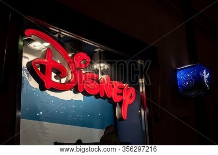 Palermo, Sicily - February 8, 2020: The Logo Of The Disney Company And The Banner With A Blue Fairy