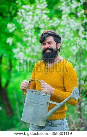 Gardening. Bearded Gardener With Gardening Watering Can. Work In Garden. Gardener Work. Farm. Work I