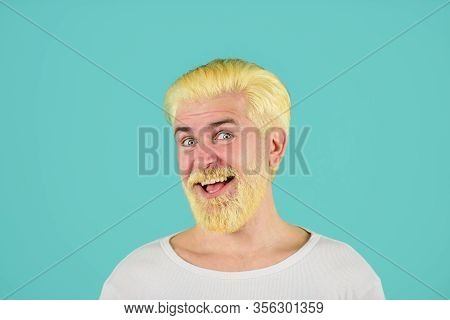 Barbershop. Modern Handsome Man With Blonde Dyed Hair. Eccentric Man With Dyed Hair. Blond Hipster G