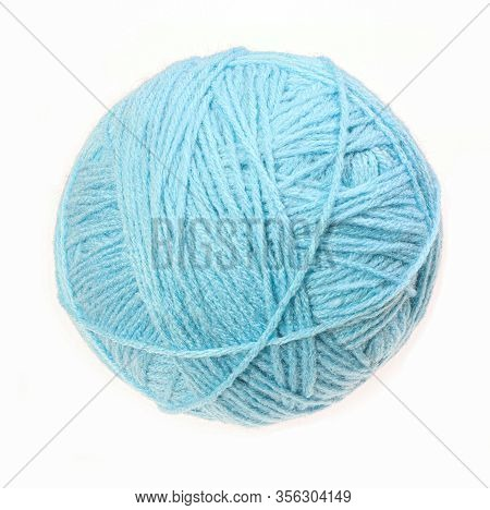 Clew Of Woolen Thread Isolated On A White Background. Blue Ball Of Woolen.
