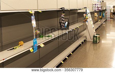 West Islip, New York, Usa - 16 March 2020: A Grocery Store Shelves Are Empty From People Hording Toi