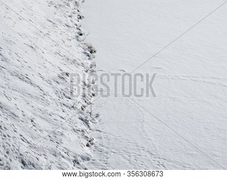 Abstract Winter Background. The Lake Shore Is Covered With White Snow. Snow-covered Landscape. Winte