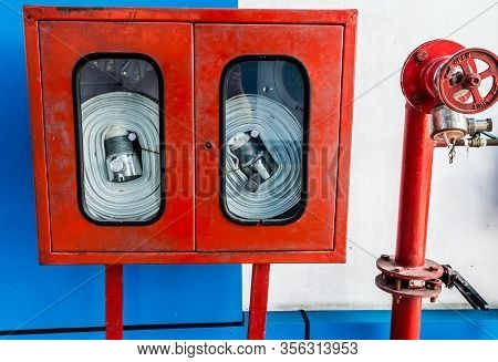 Wall Hanging Fire Extinguisher, Fire Safety And Emergency Equipment Install In Red Blue Box Wall Mou