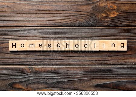 Homeschooling Word Written On Wood Block. Homeschooling Text On Wooden Table For Your Desing, Top Vi