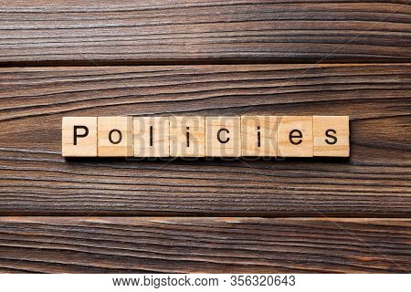 Policies Word Written On Wood Block. Policies Text On Table, Concept