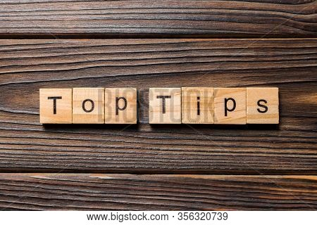 Top Tips Word Written On Wood Block. Top Tips Text On Wooden Table For Your Desing, Top View Concept