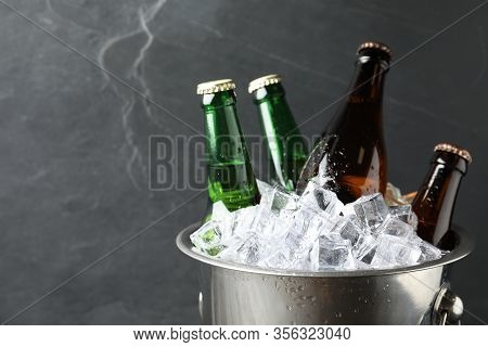 Metal Bucket With Beer And Ice Cubes On Grey Background, Closeup. Space For Text