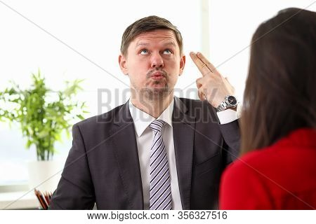 Young Businessman In Official Clothing Feeling Mad And Showing Discontent To Woman Colleague. Busine
