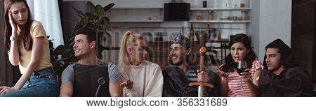 Panoramic Shot Of Men In Fairy Costumes Near Discouraged Girls