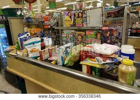Orlando, Fl/usa-3/15//20: A Typical Grocery Checkout Counter Filled With Food And Disinfectant Clean