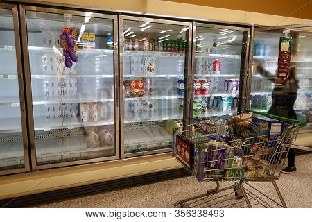 Orlando, Fl/usa-3/14//20: Empty Milk  Display Shelves At A Publix Grocery Store Due To The People Pa