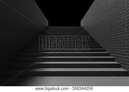 Black Staircase With Black Stairs And Brick Walls And Shadow In Underground Passage Going Up In The