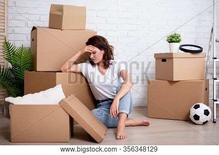 Financial Or Relationship Problems - Young Stressful Woman Sitting With Cardboard Boxes Ready To Mov