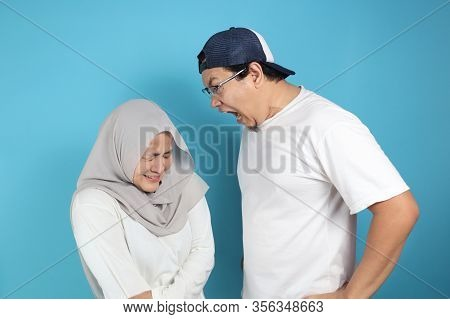 Muslim Couple Having Conflict, Wife Afraid To Her Husband Concept