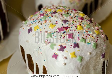 Traditional Delicious Celebration Easter Bread With White Glaze And Colourful Candy Powder On A Plat