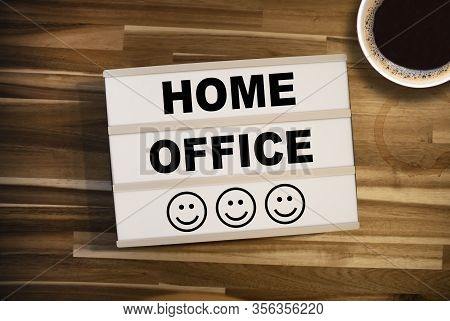 Lightbox Or Light Box With Message Homeoffice On A Wooden Table With Cup Of Coffee