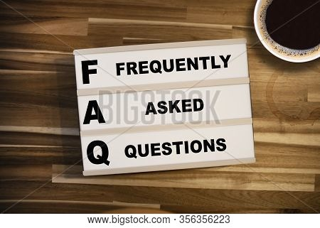 Lightbox Or Light Box With Acronym Faq Frequently Asked Questions On A Wooden Table Background