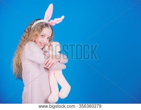 Bunny Girl With Cute Toy On Blue Background. Child Smiling Play Bunny Toy. Happy Childhood. Get In E