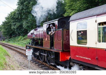 Newby Bridge, England - August 8:  Victor, A Preserved Steam Locomotive, Departs Newby Bridge Halt O