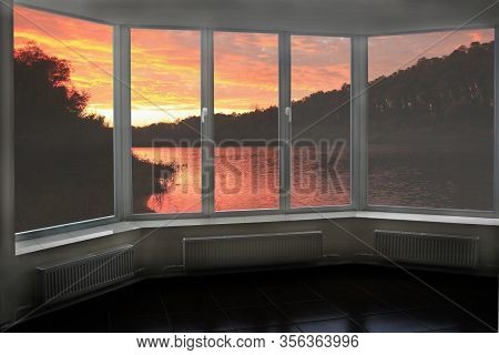 Plastic Windows Overlooking Beautiful Crimson Sunset Above River. View From Home Window At Sunset. C
