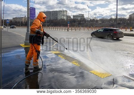 Road Worker Cleaning City Street With High Pressure Power Washer, Cleaning Dirty Public Transport St