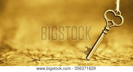 Antique Solution Key, Web Banner On Gold Background. Life Coaching, Success Concept. Copy Space.