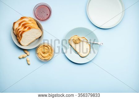 Top View, Flat Lay Process Of Cooking Breakfast, Spreading Bread, Toast With Peanut Butter, Creamy P