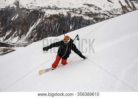 Male Freerider Glides Down The Mountain Slope