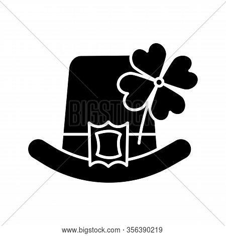 Saint Patricks Day Glyph Icon. March 17th. Leprechaun Hat With Four Leaf Clover. Silhouette Symbol.