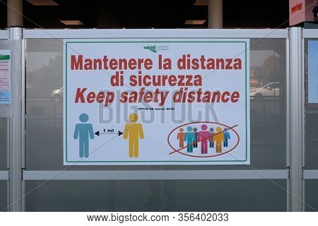 Catania, Italy - March 12, 2020: Coronavirus in Italy. Quarantine announcement about one meter distance between people as prevention mesure against Covid-19 virus epidemic in Italy