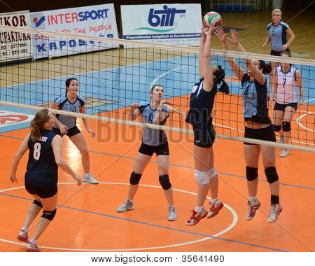 KAPOSVAR, HUNGARY - MARCH 16: Unidentified players in action at the Hungarian Championship volleyball game Kaposvar (blue) vs Palota (deep blue), March 16, 2012 in Kaposvar, Hungary.