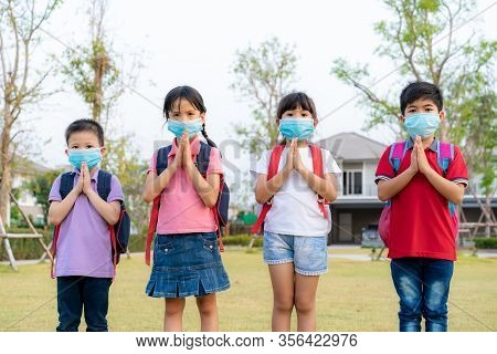 Pay Respect Is New Novel Greeting To Avoid The Spread Of Coronavirus. Four Asian Children Preschool