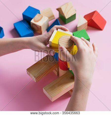 Little Kid Plays Assemble With Wooden Cubes Constructor. Education Concept For Children Learning. Ch