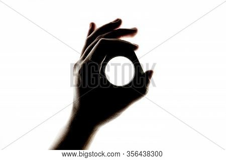 Dark Silhouette Of Female Hand Holding A Large Industrial Hex Nut Fastener And Making The Ok Hand Si