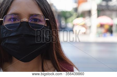 Diverse Asian Girl Wearing Protective Face Mask To Protect City Pollution And Viral Respiratory Dise